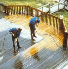 Deck being pressure washed highlights the amount of dirt and grime on the deck surface